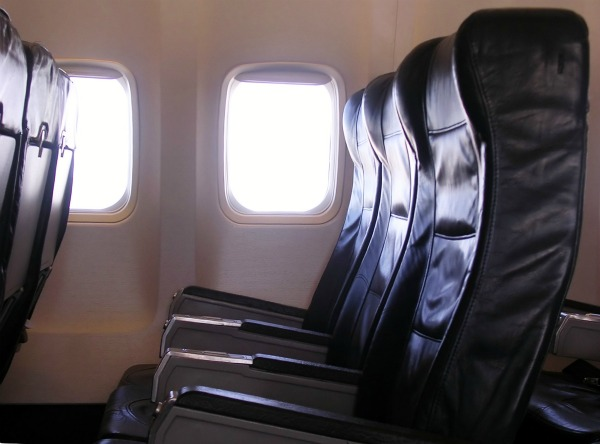 9 ways to make airplane travel suck less manjr for Chair next to window