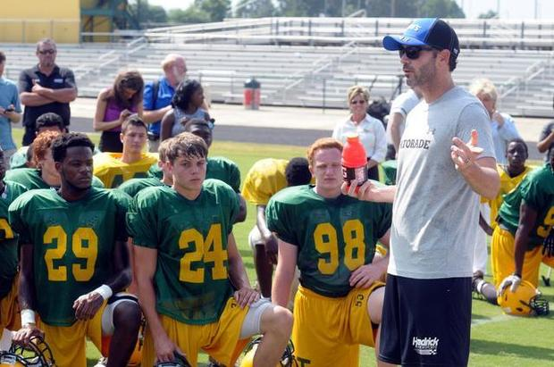 hendrick motorsports driver jimmie johnson and the hendrick motorsports 48 pit crew team surprised the independence high school football team in charlotte